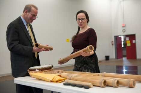 COURTESY WASHINGTON NATIONAL OPERA  Washington National Opera Executive Director Michael Mael and composer Luna Pearl Woolf look over the Hawaiian instrument known as kaekeeke, or bamboo tubes.